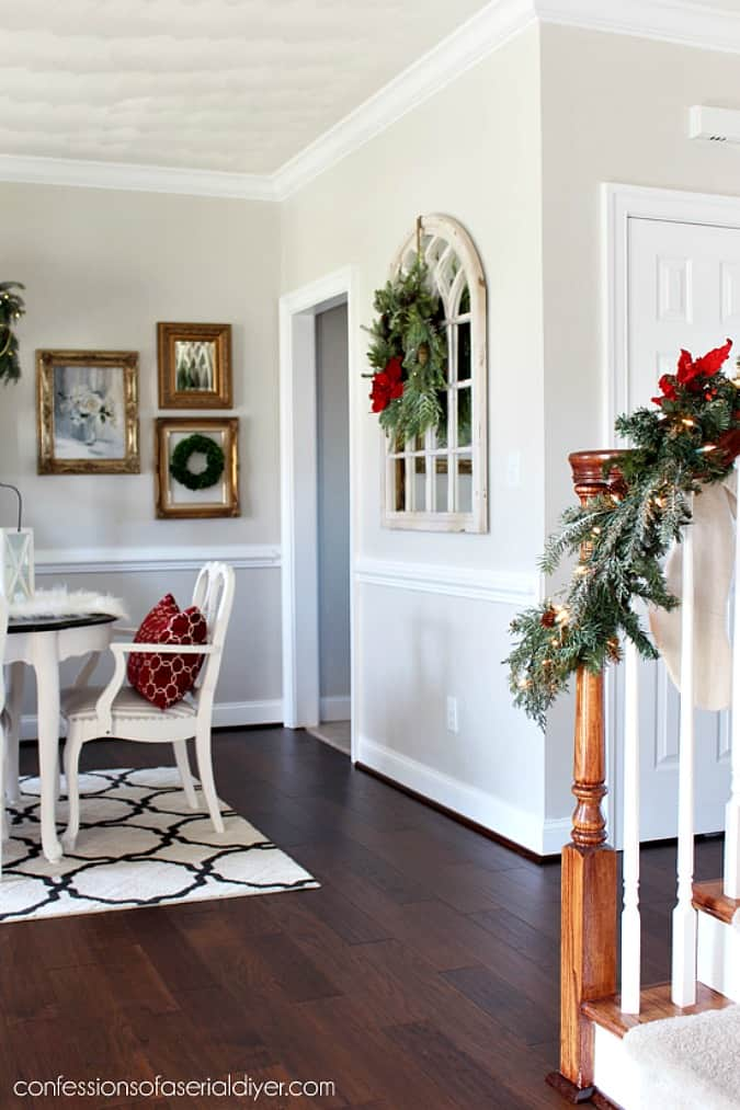 help me choose a living room paint color confessions dining room decorated for Christmas with greenery and gold artwork