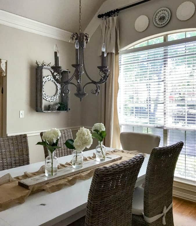 help me choose a living room paint color county road 407 dining room with beige paint chandelier large window and table and chairs with hydrangea center piece