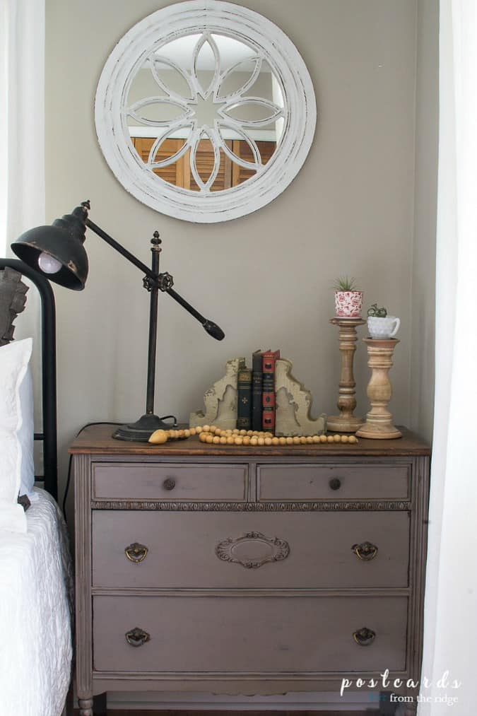 help me choose a living room paint color postcardsfromtheridge bedroom with wrought iron bed wood mirror nightstand and black lamp with decor items