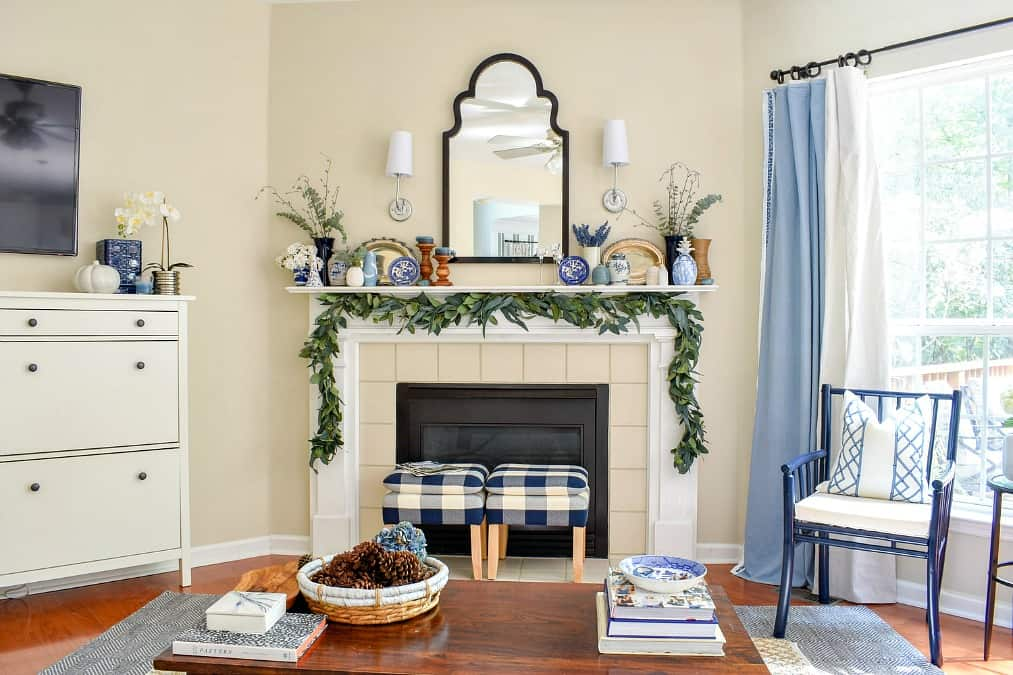 help me choose a living room paint color tmoore living room with coffee table fireplace and decorated mantle with sideboard chair and stools