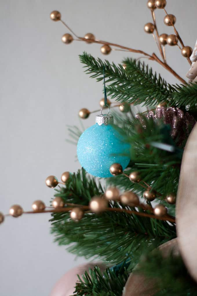 easy diy coastal christmas ornaments aqua sparkle ornament on tree with blue ornaments and linen ribbon