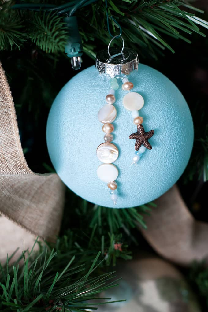 easy diy coastal christmas ornaments sea glass ornament with bead charms on tree with linen ribbon