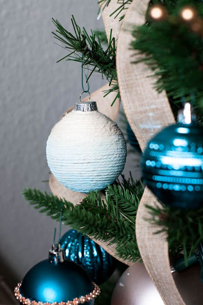 easy diy coastal christmas ornaments cotton twine ornament on tree with blue ornaments and linen ribbon