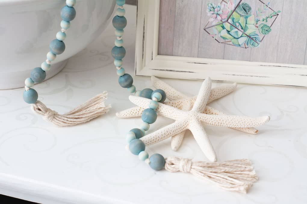 best of my wee abode 2018 wooden bead garland on white surface with star fish and frame
