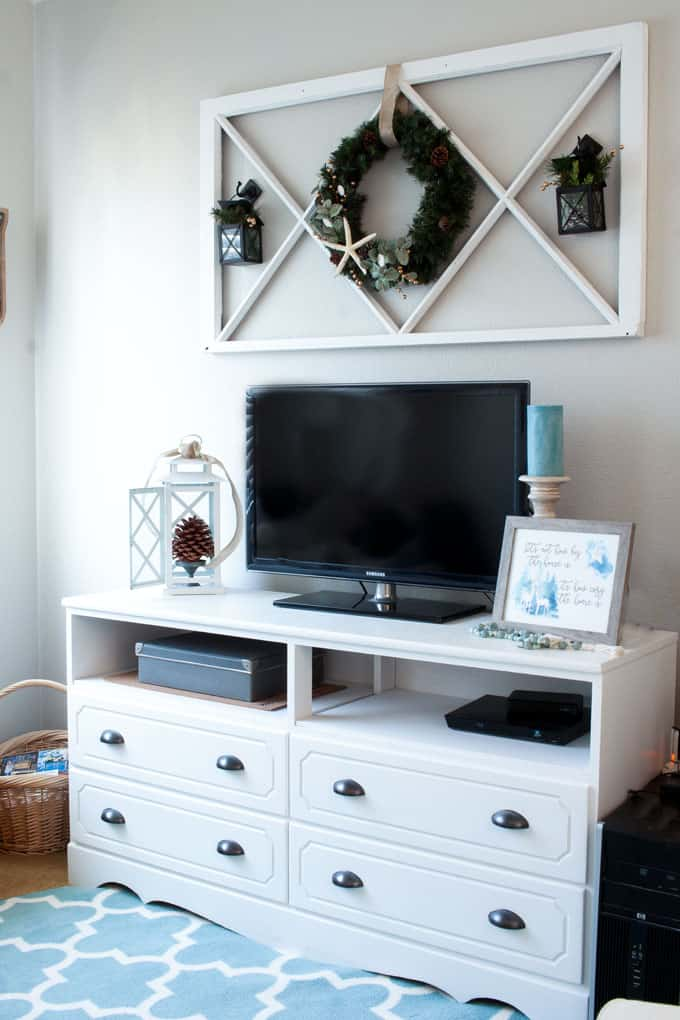 diy coastal farmhouse winter wreath on wall in living room above console with winter decor