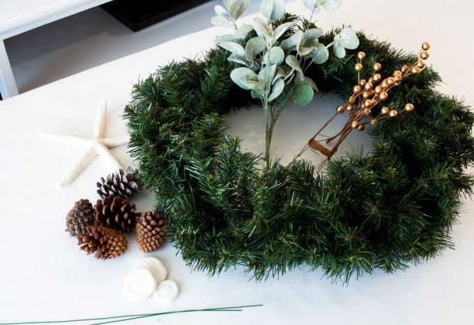 diy coastal farmhouse winter wreath supplies on white surface