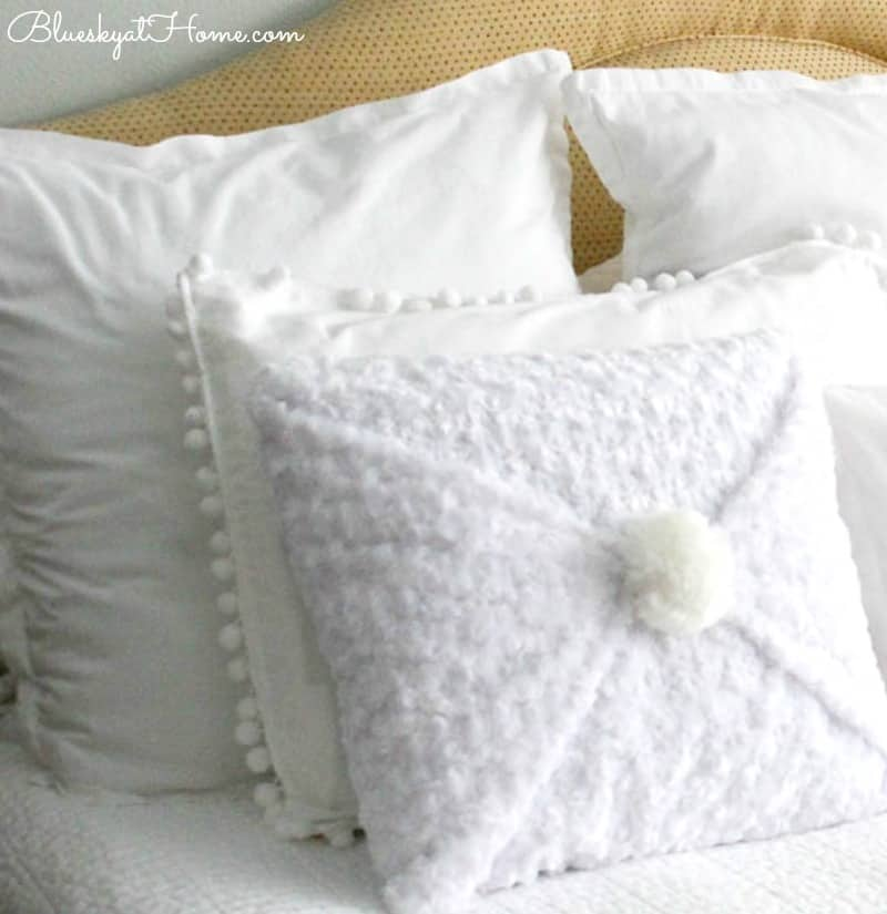 homestyle gathering 3 white pillows on a bed
