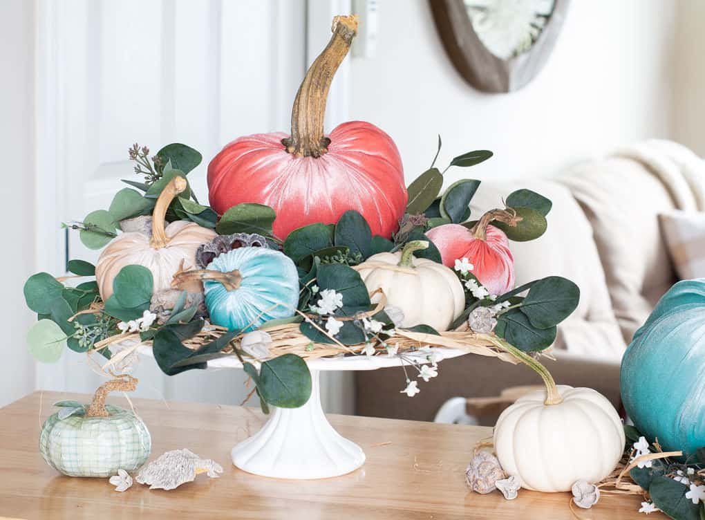 one year blogiversary small home giveaway velvet pumpkins with natural elements on cakeplate sitting on wood surface