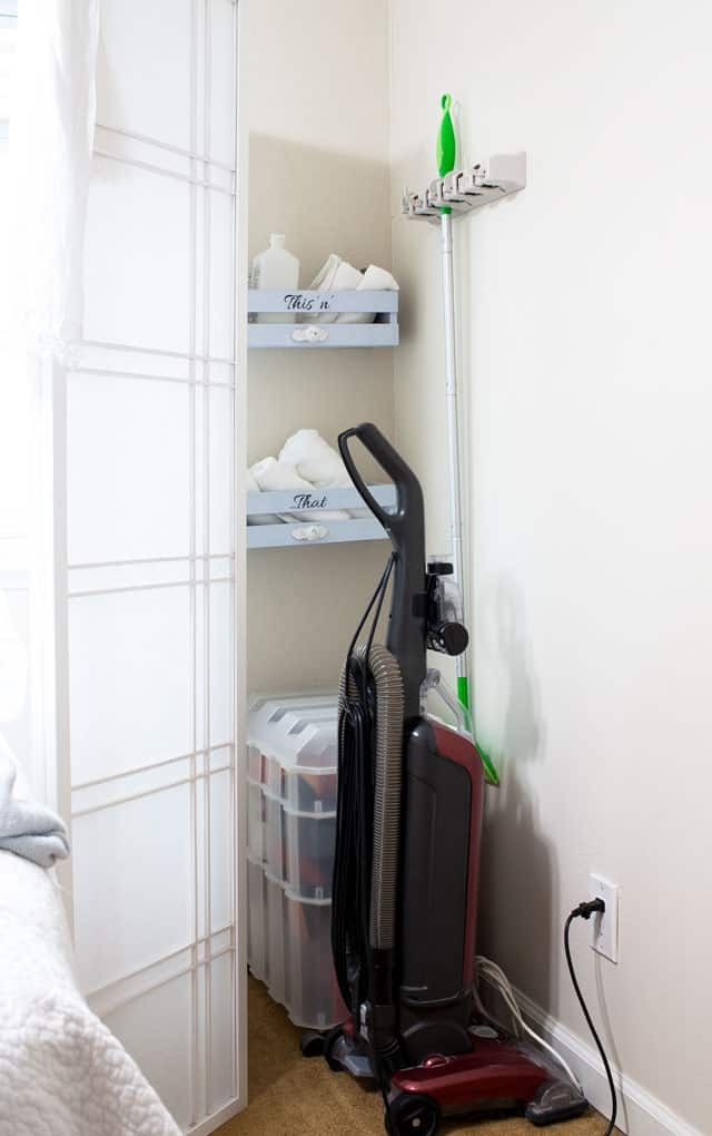 add closet small space crate shelves on wall with broom hanging on wall vacuum