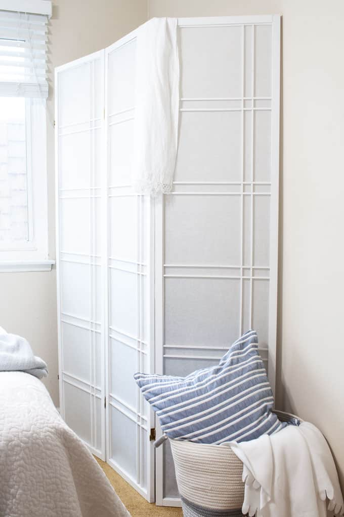 one year blogiversary small home giveaway white room divider with basket and pillows near bed with window in background