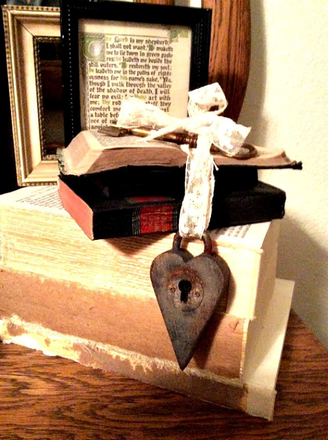 homestyle gathering 7 heart padlock on stack of books with lace ribbon
