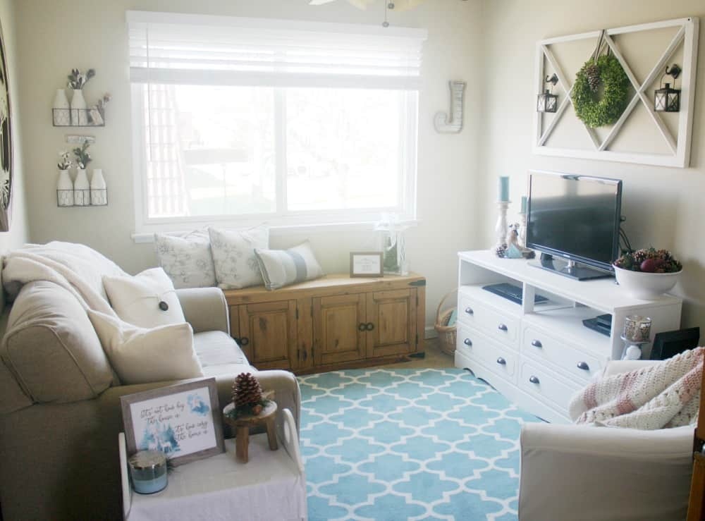 one year blogiversary small home giveaway living room with furniture and big window with aqua rug