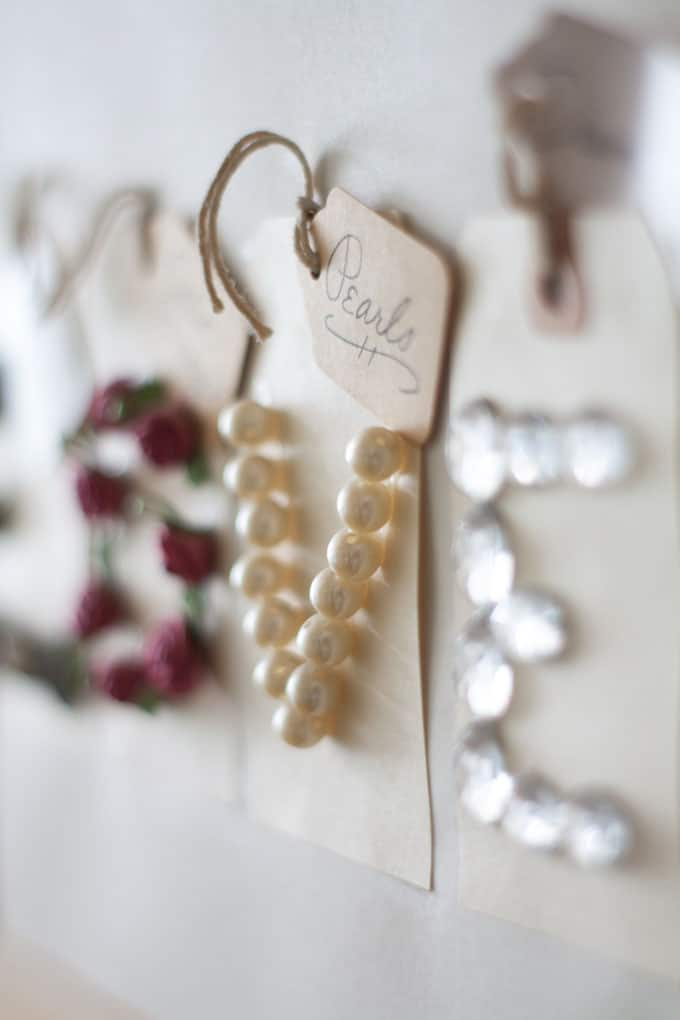 quick farmhouse makeover outdated frames close up of pearls and tag that says pearls