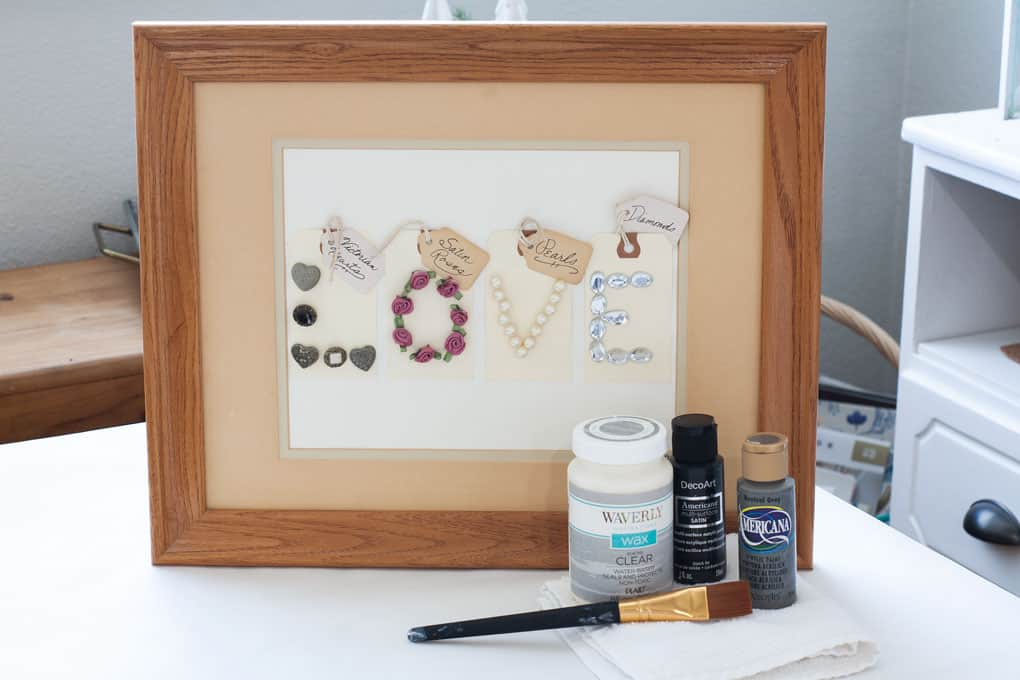 quick farmhouse makeover outdated frames artwork with craft supplies on table
