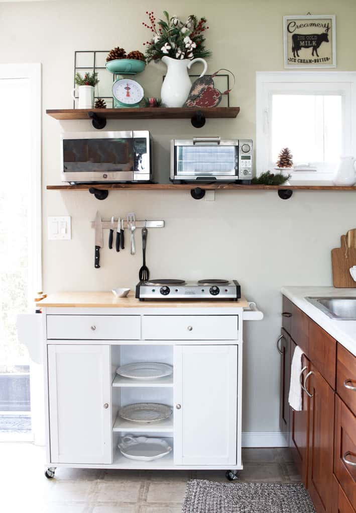 winter-valentine-decor-small-kitchen white dishes on open shelving in a kitchen