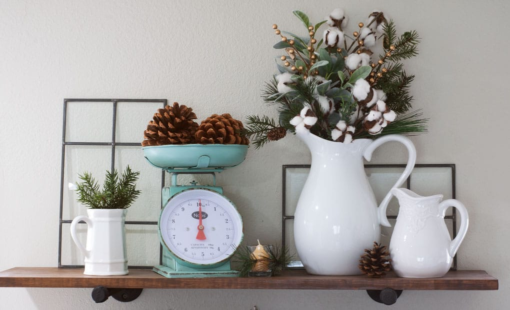 winter-valentine-decor-small-kitchen open shelving with scale white pitchers pine cones and greenery