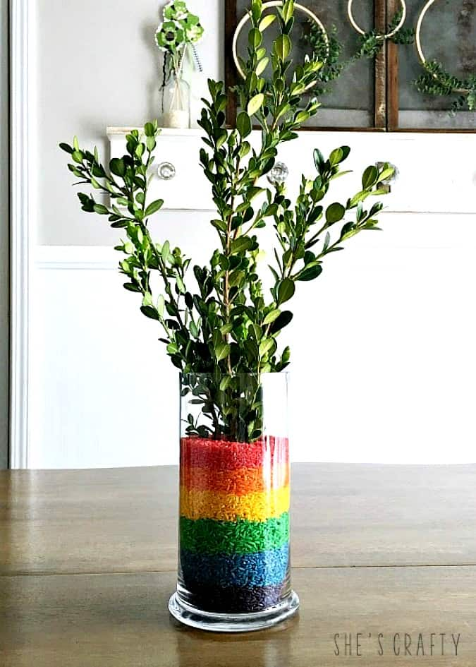 homestyle gathering 11 rainbow colored rice in vase with greenery on table