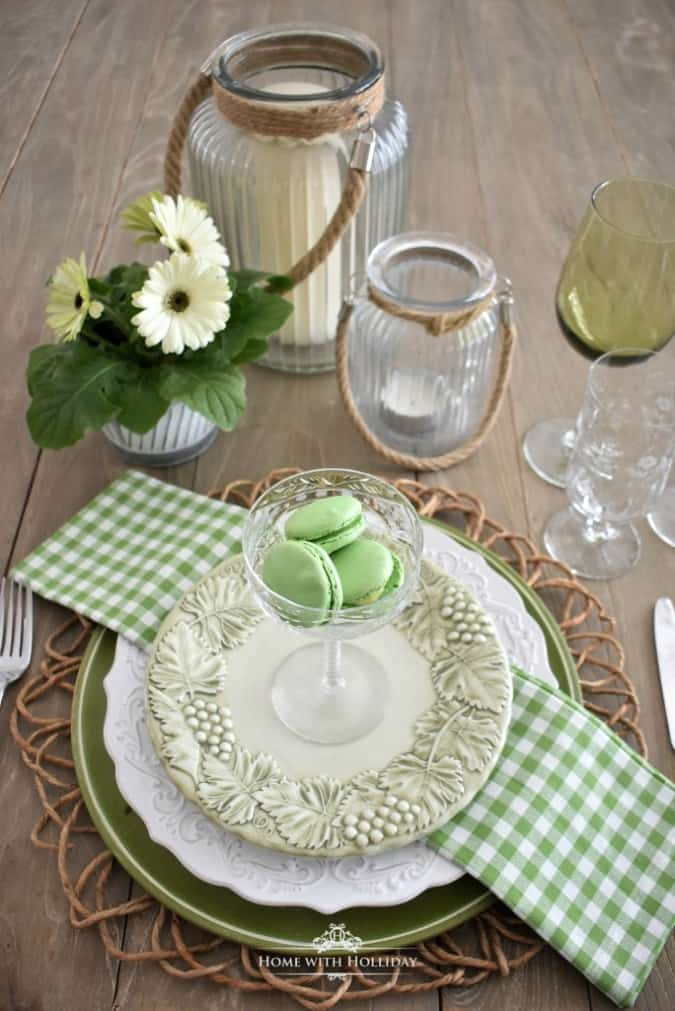 homestyle gathering 11 table setting with dishes and stemware and green accents and linens