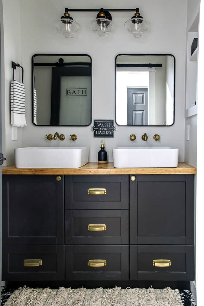 homestyle gathering 9 bathroom with black cabinets and white sinks and mirrors