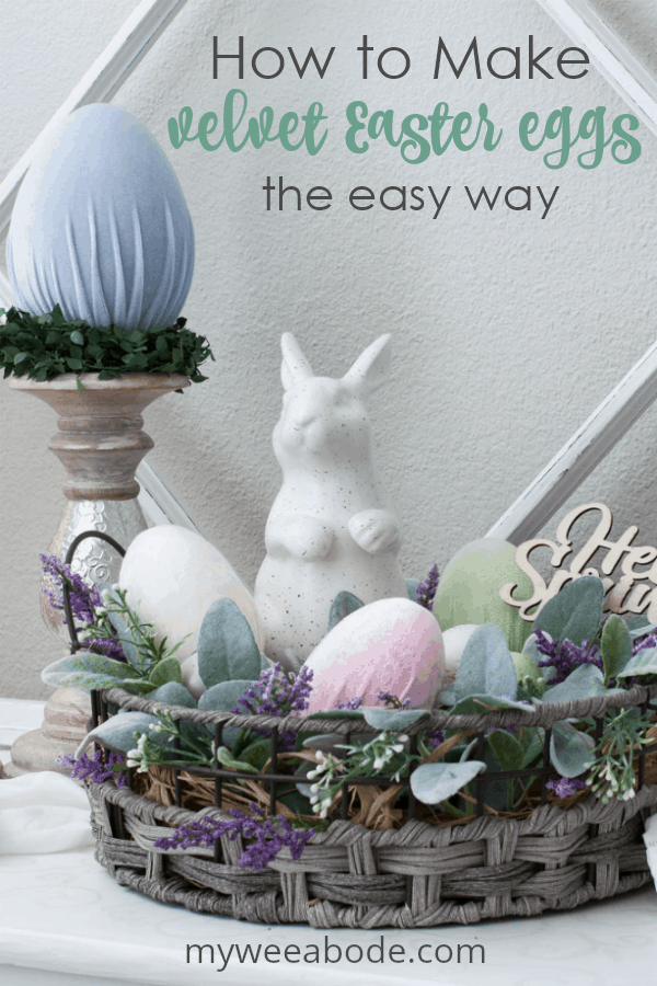 how to make velvet easter eggs vignette with candle holder and velvet egg with basket bunny lambs ear florals on white surface with window pane in background