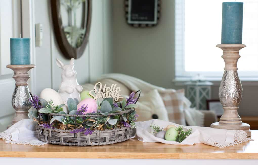 spring centerpiece velvet easter eggs centerpiece with wooden bowl florals eggs and bunny on table with candlestick