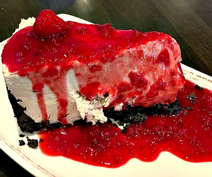 raspberry cheesecake on white plate