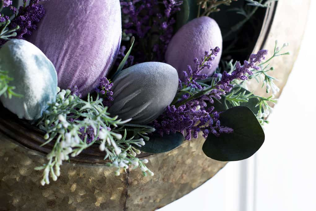 galvanized tire wreath with florals and velvet eggs