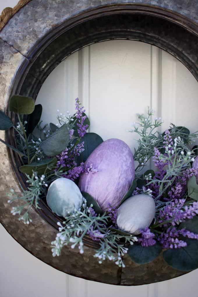spring decorating ideas using velvet easter eggs galvanized tire wreath with florals and velvet eggs