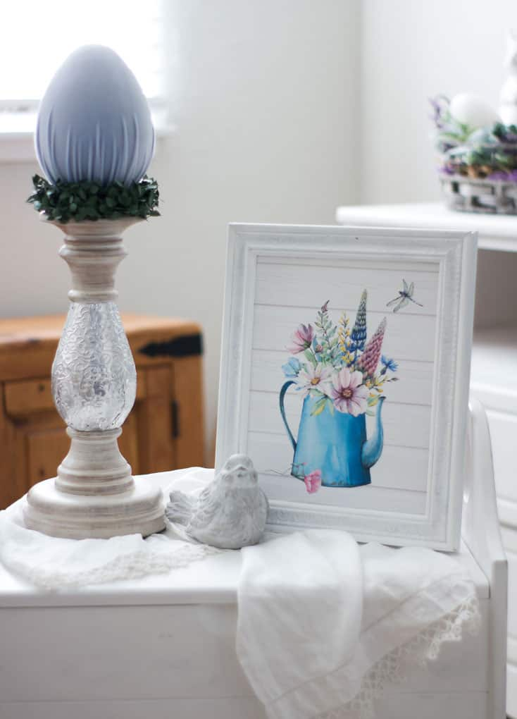 spring decorating ideas using velvet easter eggs vignette with candle holder and velvet egg and spring printable in frame with bird on linen cloth