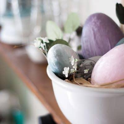 spring decorating ideas using velvet easter eggs bowl of velvet egs and faux flower on shelf