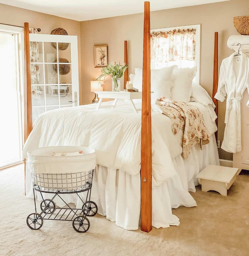 guest bedroom with furniture and linens in creamy whites and vintage accessories