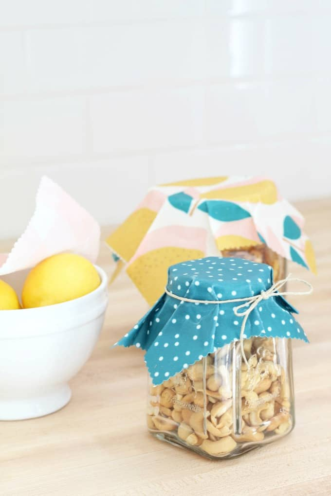 homestyle gathering 16 jars with beeswax wraps and bowl of lemons on wood surface