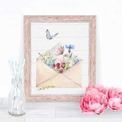 free spring watercolor wall art watering can with spring flowers on surface with pink flowers and straws in a bottle