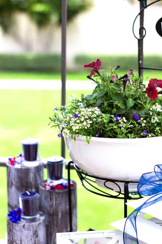 small porch 4th july decor ideas with plants lantern candles and garland