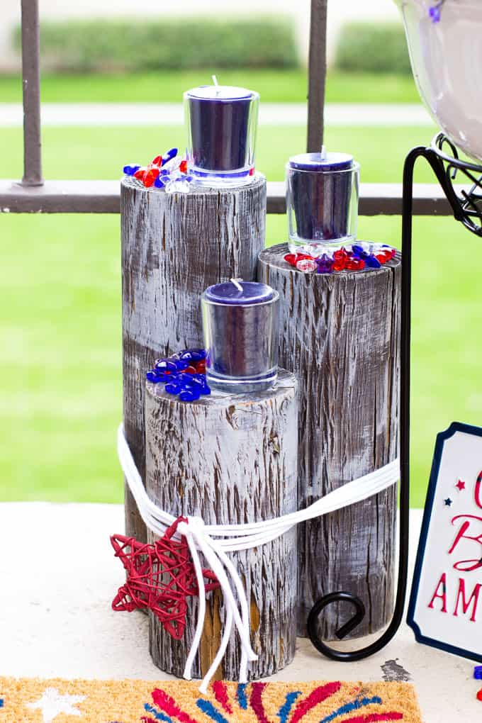 small porch decor red white blue with wood piling candles and stars outside