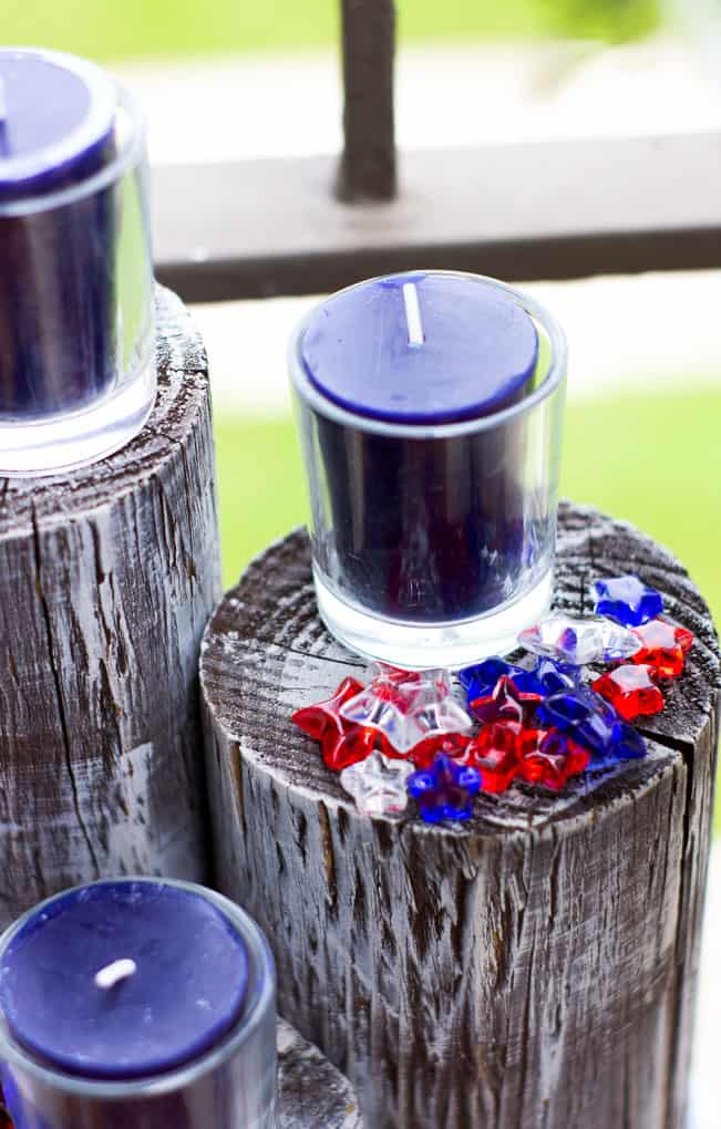 small porch 4th july decor ideas with wood piling candles and stars outside
