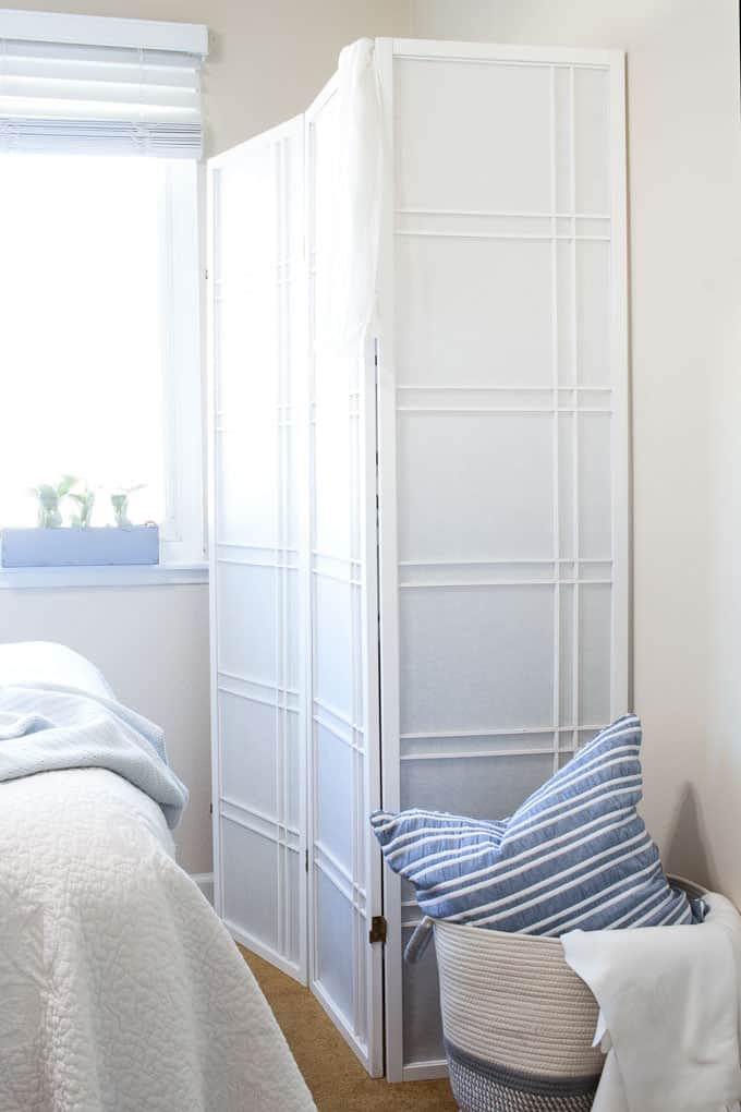 easy apartment decor hacks free standing closet using a room divider basket with pillow and bed
