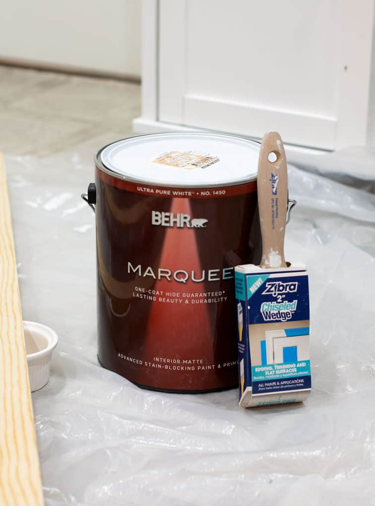 create temporary accent wall can of paint and brush on floor