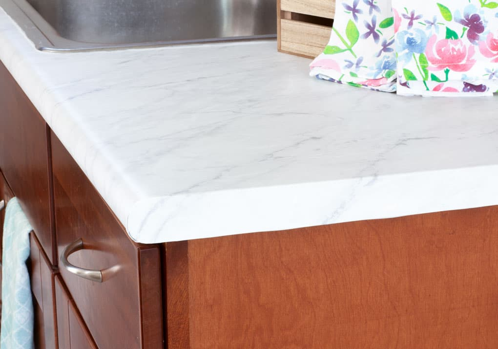 easy apartment decor hacks faux marble counter on wooden cabinets