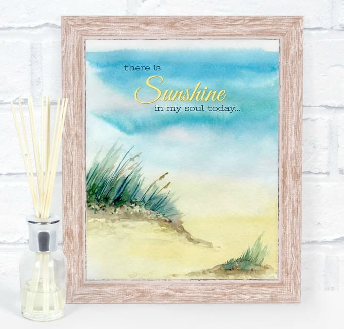 free summer watercolor printable of a beach scene with a brick wall in background and reed diffuser on surface