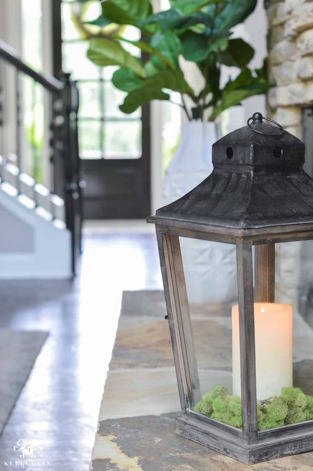easy summer mantel decor candle lantern on rock hearth