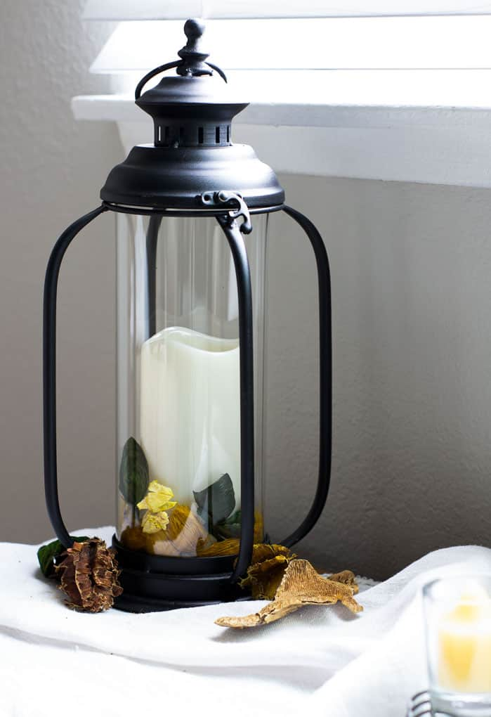easy summer mantel decor black lantern with candles and natural elements