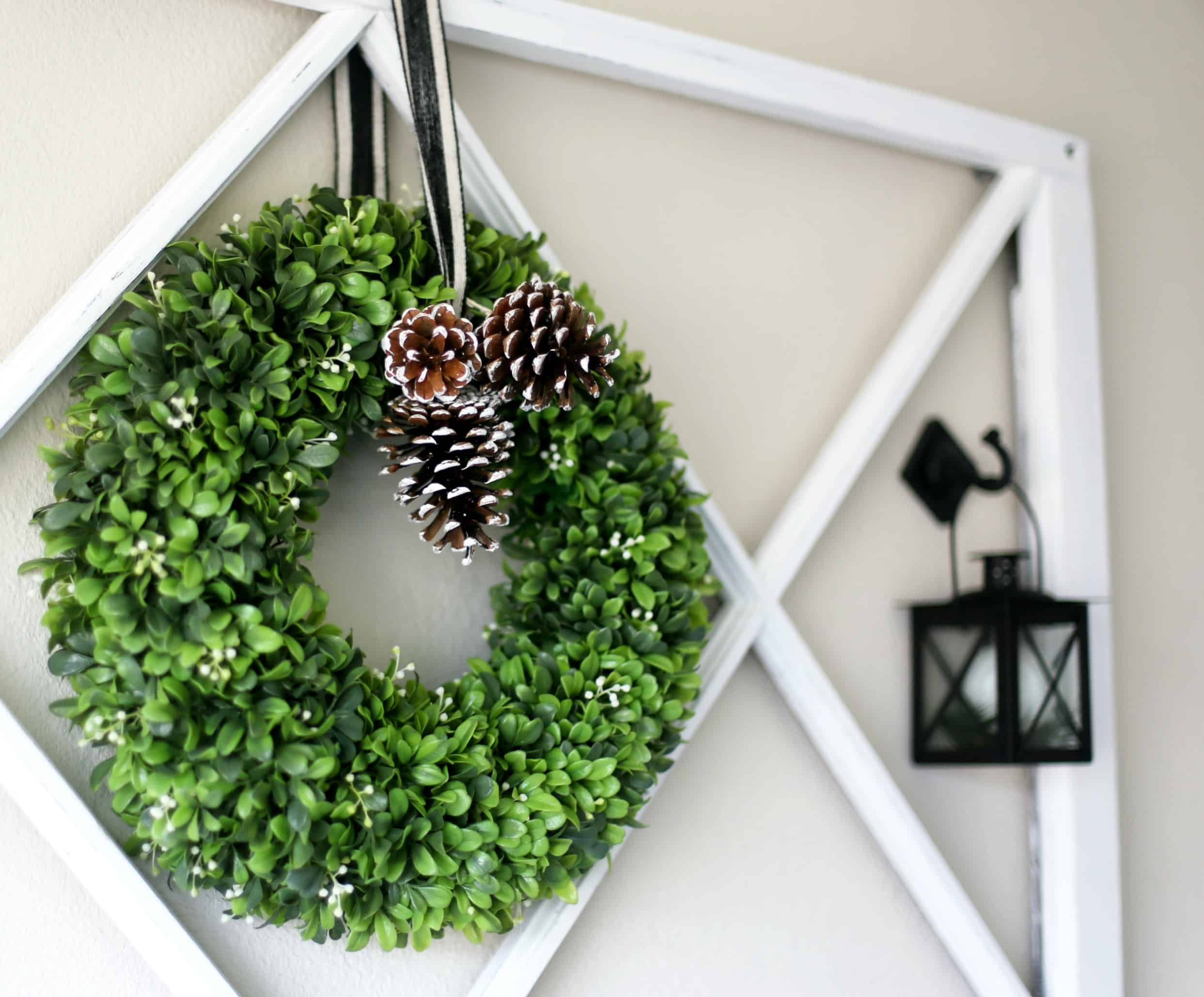 how to decorate a window pane for all seasons boxwood wreath window pane and lantern on wall