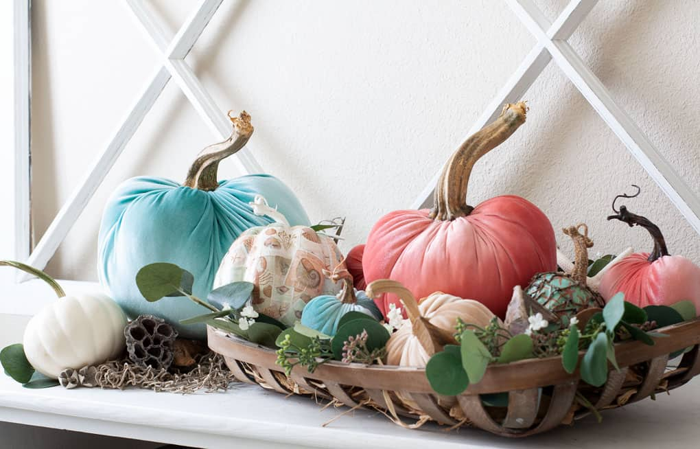 diy velvet pumpkins against a wooden window pane backdrop