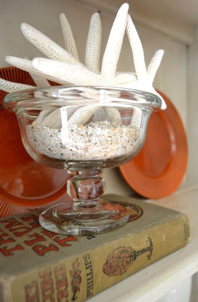 tuesday turn about link party 3 glass pedestal bowl with sand and starfish on vintage book