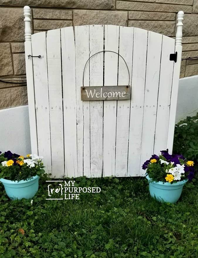 tuesday turn about link party 4 wooden gate with potted flowers in yard with sign that reads welcome