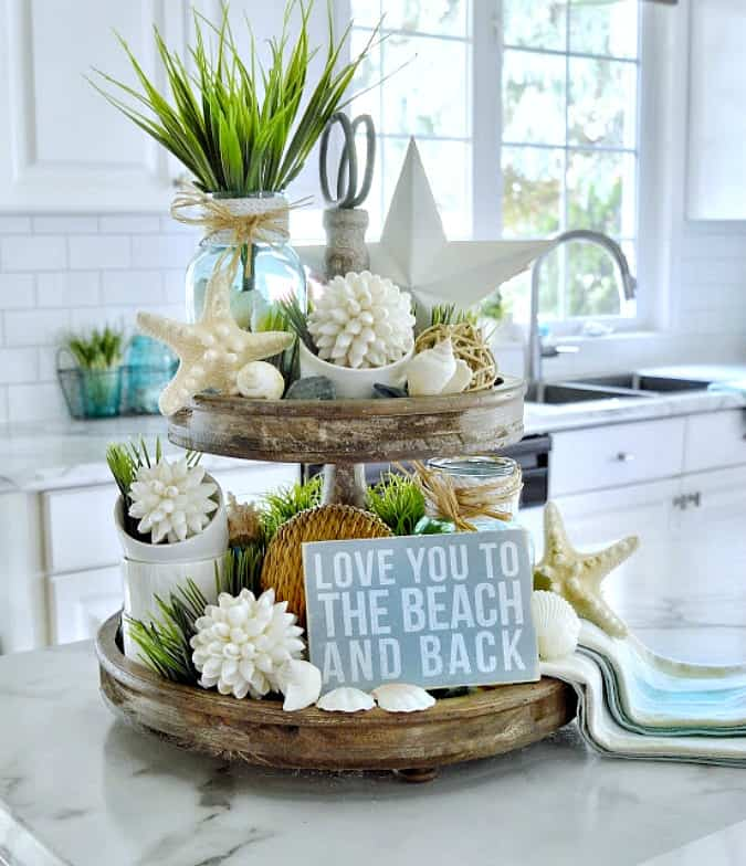tuesday turn about link party 4 tiered shelf unit with coastal decor in white and blue