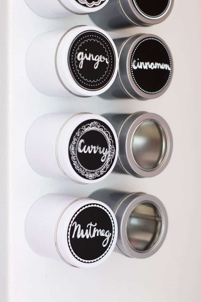 space saving spice storage spice tins on refrigerator