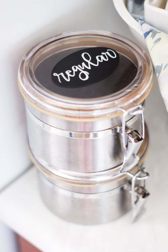 space saving spice storage coffee tins on white counter