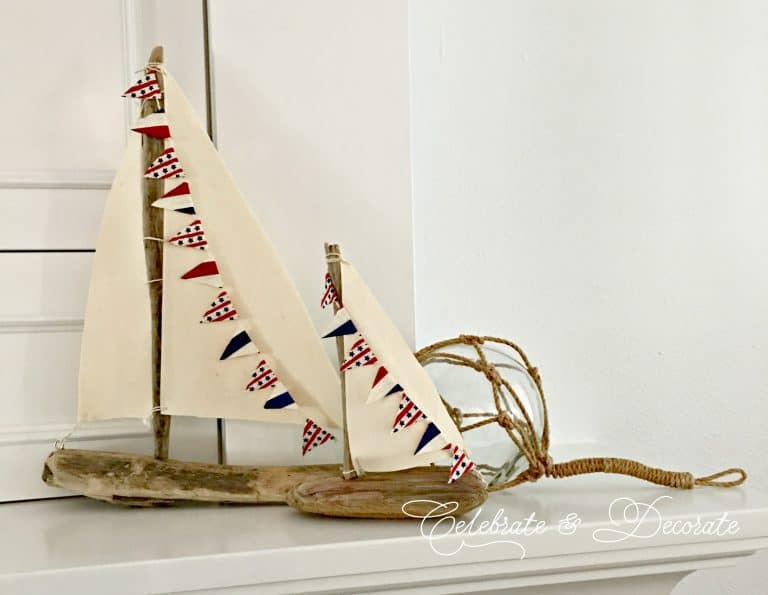 sailboats created from driftwood and muslin fabric with rope ball in background